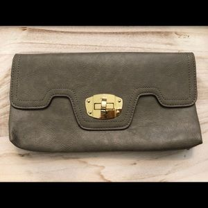 Grey clutch with gold hardware